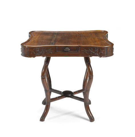 A rosewood game table 20th century