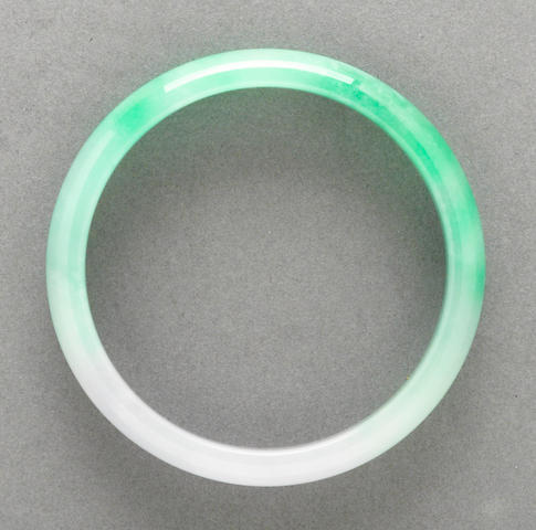 A mottled green and pale lavender jadeite bangle
