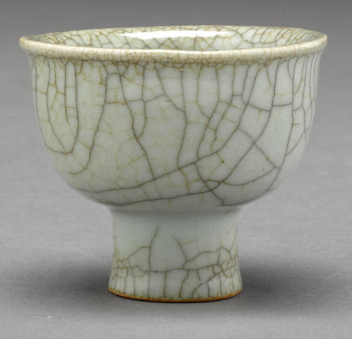 A crackled celadon glazed porcelain stem cup