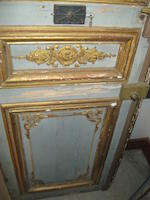 A pair of Neoclassical style paint decorated boiserie paneled doors