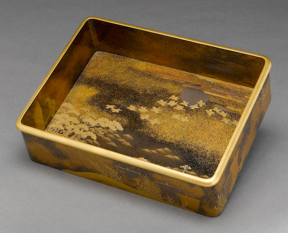 A gilt and black lacquer storage tray  Meiji period