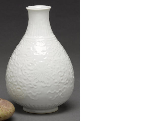 A white porcelain vase with molded decoration Qianlong mark, Republic period