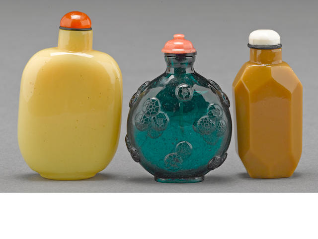 A group of three glass snuff bottles 1880-1940