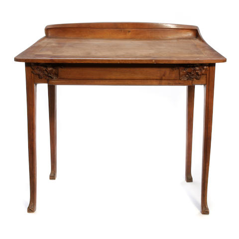 An Art Nouveau walnut desk circa 1900
