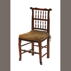 A set of four English oak spindle back side chairs together with a similar armchair, 19th century
