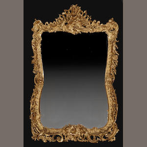 A fine and large Louis XV style giltwood mirror. fourth quarter 19th century