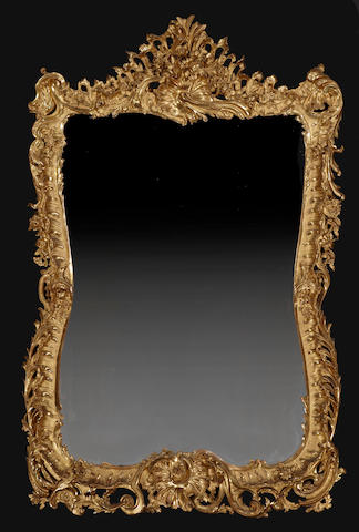 A fine and impressive Louis XV style giltwood mirror<BR />fourth quarter 19th century