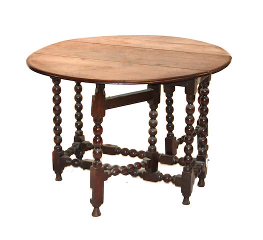 A William and Mary oak gateleg table composed of antique elements