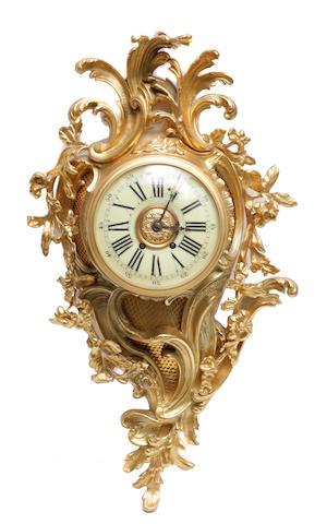 A Louis XV style gilt metal cartel clock