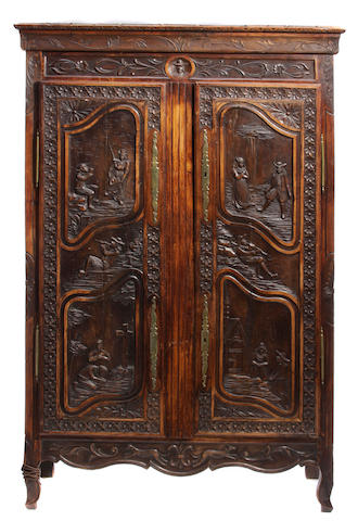 A French Provincial oak armoire