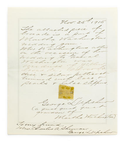 "WASHINGTON, MARTHA. 1731-1802. A swatch of fabric from the wedding gown worn by Martha Washington, yellow brocade, approximately ¾ x ¾ inches, pinned to an Autograph Note Signed (""George L. Upshur""),"