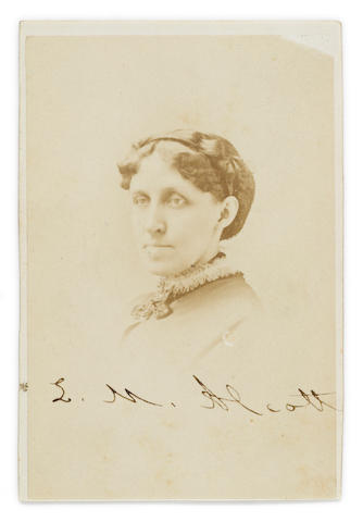 "ALCOTT, LOUISA MAY. 1832-1888. Photograph Signed (""L.M. Alcott""), albumen print carte de visite, 3¾ x 2½ inches (card size), 1870, Allen studio (Boston) monogram and address on verso, tiny chip to upper corner, mount marks to verso."