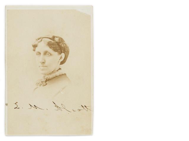 "ALCOTT, LOUISA MAY. 1832-1888. Photograph Signed (""L.M. Alcott""), albumen print carte de visite, 3.75 x 2.5 (card size), 1870, Allen studio (Boston) monogram and address on verso, tiny chip to upper corner, mount marks to verso."
