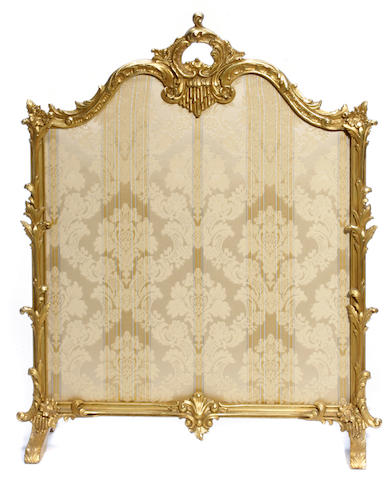 A Louis XV style giltwood firescreen