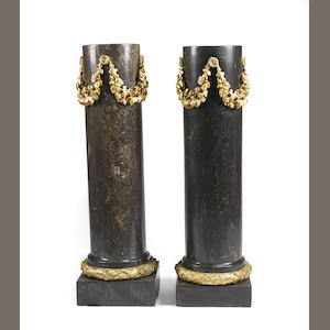 A pair of Louis XVI style gilt bronze mounted black and gray marble columnar pedestals. second half 20th century