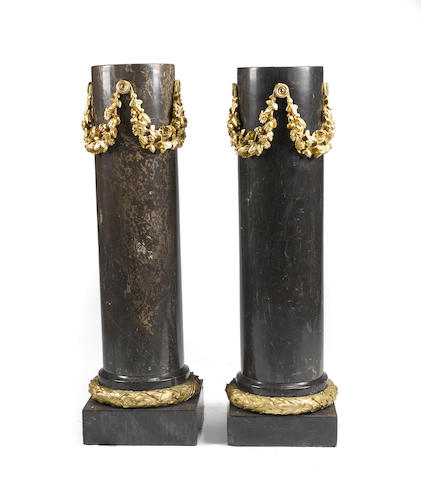 A pair of Louis XVI style gilt bronze mounted black and gray marble columnar pedestals<BR />second half 20th century