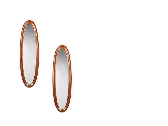 A pair of wood framed oval mirrors Campo and Graffi, Torino, Italy c 1960