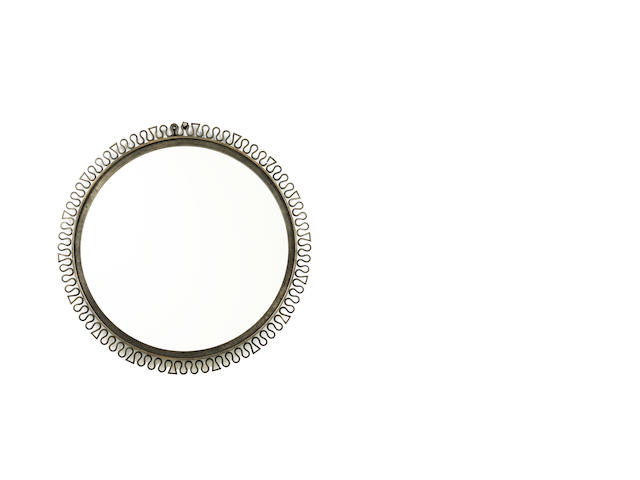 A circular mirror with wrought iron frame French c 1950