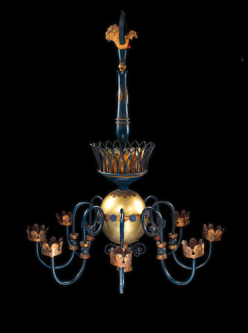 A Brass Chandelier Attributed to Gilbert Poillerat Second half of the 20th Century  gilded metal, painted metal and ceramic  Height: 61 1/4 in. 155.5 cm.