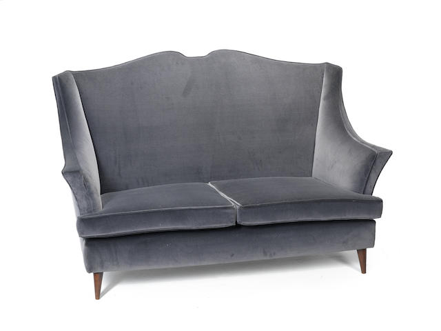A dark grey velvet upholstered wingback sofa Italy c 1950