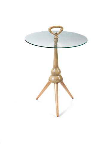 A vellum covered side table with circular glass top on three legs Italian c 1950