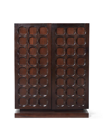 A Cabinet Belgian, circa 1970  stained mahogany, the interior with adjustable shelves  55 1/2 x 43 11/16 x 18 1/8 in. 141 x 111 x 46 cm.