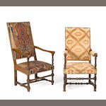 A set of two late Louis XIV walnut armchairs
