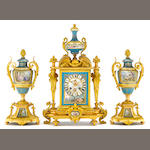 A French gilt bronze and Sèvres style porcelain mounted three piece clock garniture<BR />S. Wartenberg, Paris<BR />fourth quarter 19th century