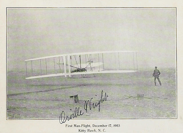 "WRIGHT, ORVILLE. 1871-1948. Postcard Signed (""Orville Wright""), 4 x 6 inch half-tone reproduction of the Kitty Hawk in flight,"