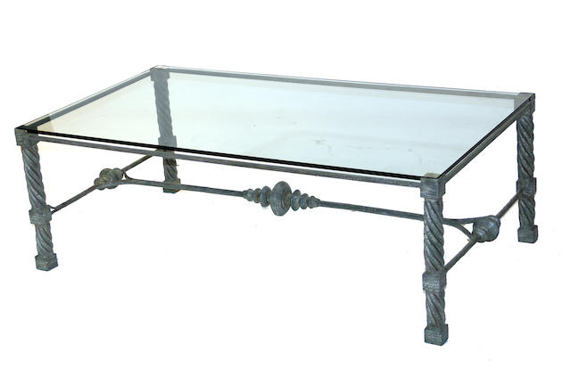 A Renaissance style patinated metal and glass custom low table  20th century