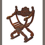 An Italian Renaissance style walnut curule base armchair late 19th century