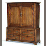 A George III inlaid oak linen press fourth quarter 18th century