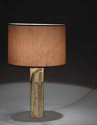 Piero Fornasetti for Fornasetti Milano A Table Lamp circa 1960  gilt and printed metal with applied label for Fornasetti Milano  Height: 17 11/16 in. 45 cm.
