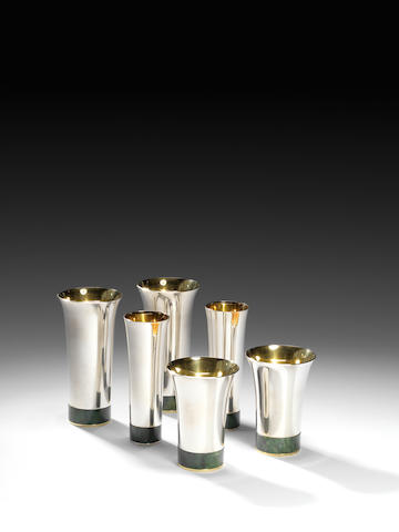 Paul Belvoir A Set of Eighteen Beakers 1989  comprising six of each in three sizes, sterling silver, silver gilt and stone<BR /> hallmarked and stamped PGB  Height: 4 1/2 - 6 5/16 in. 11.5 - 16 cm.