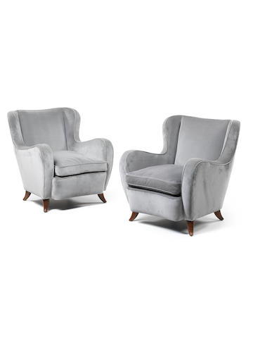 A pair of upholstered armchairs with wooden legs Italian c 1950