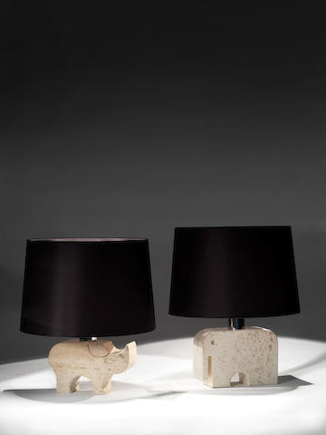 A Pair of Table Lamps Italian, circa 1970  carved travertine, modelled as an elephant and rhinoceros  Height: 10 7/16 - 11 1/4 in. 26.5 - 28.5 cm.