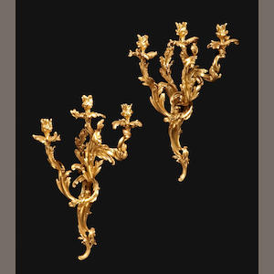 A pair of Louis XV style gilt bronze three light bras de lumière . 19th century