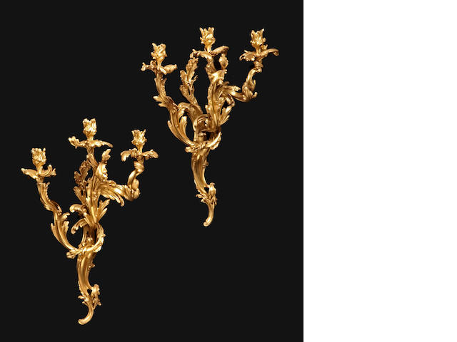 A pair of Louis XV style gilt bronze three light bras de lumière <BR />19th century