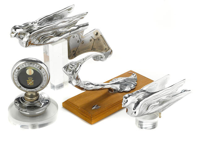 A grouping of 1930s and 1940s era Cadillac mascots,
