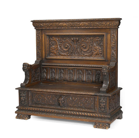 An American Renaissance style carved oak hall bench, possibly Horner Brothers <BR />late 19th century