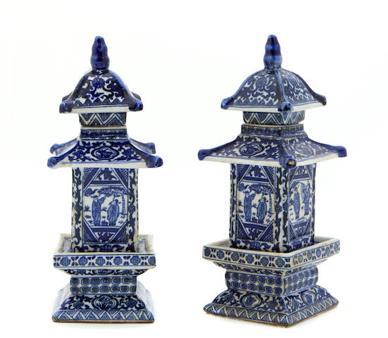 A small pair of Chinese blue and white porcelain pagoda form covered jars