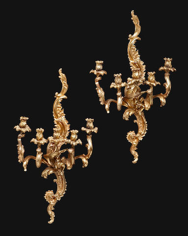 A pair of Louis XV style five light figural bras de lumière<BR />late 19th/early 20th century