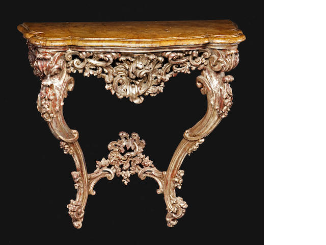 An Italian Rococo style silver gilt and faux marble console table <BR />mid 19th century