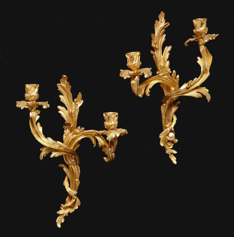 A pair of Louis XV style gilt bronze two light bras de lumière<BR />Thiébaut Frères foundry, Paris<BR />late 19th century