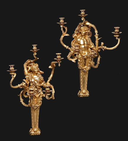 A pair of Régence style gilt bronze five light bras de lumière<BR />late 19th century