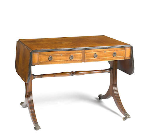 A Regency inlaid mahogany and rosewood sofa table first quarter 19th century