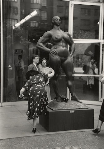 Ruth Orkin (1921-1985); Woman Shaking Pebble from her Shoe, MOMA Garden, Gaston Lachaise sculpture, NYC;