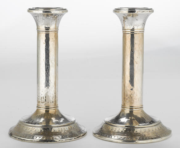 A George V silver pair of columnar candlesticks with stamped decoration Liberty & Co., Birmingham, 1919 <BR /># 2285