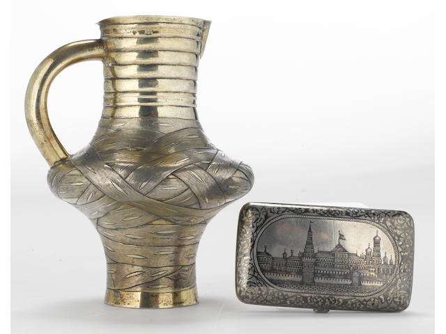 A Russian 84 standard silver-gilt trompe l'oeil jug with an 84 standard silver and niello cigarette case Alexei Osipov, Moscow, 1867 Gustav Klingert, Moscow, 1899-1908  (2)