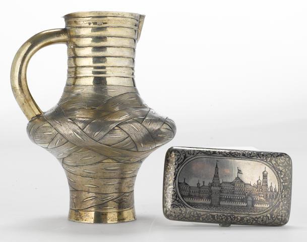 A Russian 84 standard silver-gilt trompe l'oeil jug with an 84 standard silver and niello cigarette case Alexei Osipov, Moscow, 1867 Gustav Klingert, Moscow, 1899-1908  (2)